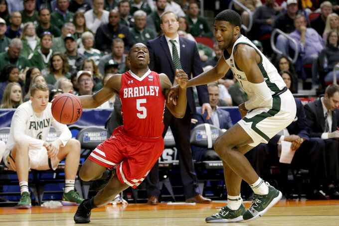 Bradley's Darrell Brown (5) is fouled by Michigan State's Aaron Henry (11) during the first half of a first round men's college basketball game in the NCAA Tournament, in Des Moines, Iowa, Thursday, March 21, 2019. (AP Photo/Nati Harnik)