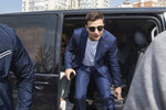 In this photo taken on Sunday, April 21, 2019, Ukrainian comedian and presidential candidate Volodymyr Zelenskiy leaves a minivan as he arrives at a polling station, during the second round of presidential elections in Kiev, Ukraine. For his presidential campaign popular Ukrainian comedian Volodymyr Zelenskiy has literally taken the script from a TV show in which he plays the Ukrainian president. (AP Photo/Zoya Shu)