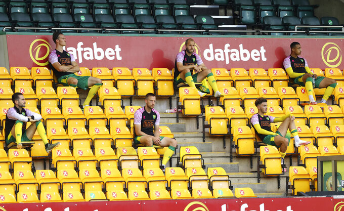 Norwich City substitutes in the stands before the English Premier League soccer match between Norwich City and Burnley at Carrow Road Stadium in Norwich, England, Saturday, July 18, 2020. (Julian Finney/Pool via AP)