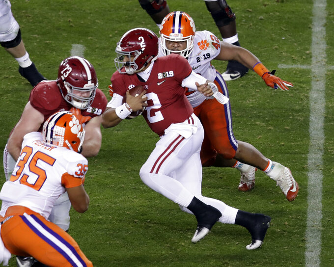Alabama's Jalen Hurts scrambles during the second half of the NCAA college football playoff championship game against Clemson, Monday, Jan. 7, 2019, in Santa Clara, Calif. (AP Photo/Jeff Chiu)