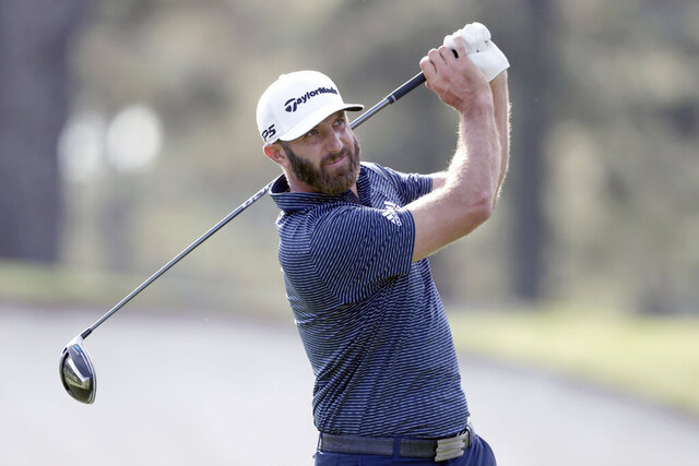 Dustin Johnson tees off on the third hole during the final round of the Masters golf tournament Sunday, Nov. 15, 2020, in Augusta, Ga. (Curtis Compton/Atlanta Journal-Constitution via AP)