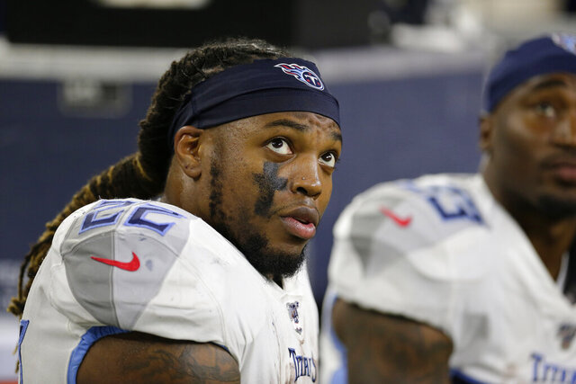 FILE — In this Dec. 29, 2019, file photo, Tennessee Titans' Derrick Henry sits on the bench during the second half of an NFL football game against the Houston Texans in Houston. The Tennessee Titans have tagged Henry as their franchise player, making sure they keep the NFL rushing leader around for at least this season. (AP Photo/Michael Wyke, File)
