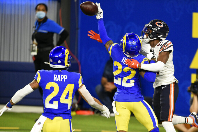 Los Angeles Rams cornerback Troy Hill (22) tips a pass in the end zone intended for Chicago Bears wide receiver Darnell Mooney, right, during the second half of an NFL football game Monday, Oct. 26, 2020, in Inglewood, Calif. The tipped pass was intercepted by Rams safety Taylor Rapp (24) for a touchback. (AP Photo/Kelvin Kuo)