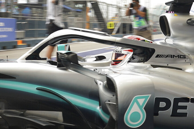 Mercedes driver Lewis Hamilton of Britain pulls out of his garage during the first practice session at the Marina Bay City Circuit ahead of the Singapore Formula One Grand Prix in Singapore, Friday, Sept. 20, 2019. (AP Photo/Vincent Thian)