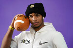 LSU wide receiver Ja'Marr Chase poses during media day for NCAA College Football Playoff national championship game Saturday, Jan. 11, 2020, in New Orleans. Clemson is scheduled to play LSU on Monday. (AP Photo/David J. Phillip).