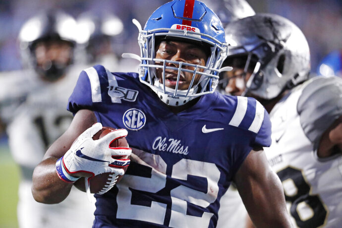 Mississippi running back Scottie Phillips (22) hears into the end zone on a 24-yard touchdown run during the second half of an NCAA college football game against Vanderbilt in Oxford, Miss., Saturday, Oct. 5, 2019. Mississippi won 31-6. (AP Photo/Rogelio V. Solis)