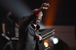 Inductee Ben Wallace pumps his fist into the air during the 2021 Basketball Hall of Fame Enshrinement ceremony, Saturday, Sept. 11, 2021, in Springfield, Mass. (AP Photo/Jessica Hill)