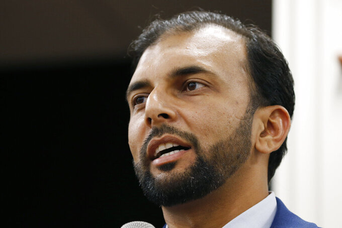 FILE - This Oct. 8, 2019, file photo shows Democratic candidate for the 28th district for the Virginia Senate, Qasim Rashid, in Fredericksburg, Va. A federal appeals court on Friday, June 4, 2021 upheld the conviction of a North Carolina man who posted an anonymous threat on social media to lynch Qasim Rashid, a Muslim-American political candidate from Virginia.. (AP Photo/Steve Helber, File)