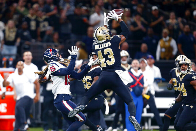 New Orleans Saints free safety Marcus Williams (43) intercepts a pass intended for Houston Texans wide receiver Will Fuller (15) in the second half of an NFL football game in New Orleans, Monday, Sept. 9, 2019. (AP Photo/Butch Dill)