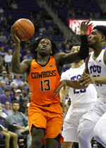 Oklahoma State guard Isaac Likekele (13) drives to the basket, defended by TCU guard Alex Robinson (25) and center Kevin Samuel (21) during the first half of an NCAA college basketball game, Wednesday, Feb. 6, 2018 in Fort Worth, Texas. (David Kent/Star-Telegram via AP)