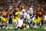 Stanford running back Cameron Scarlett, center, carries against Southern California during the first half of an NCAA college football game Saturday, Sept. 7, 2019, in Los Angeles. (AP Photo/Marcio Jose Sanchez)
