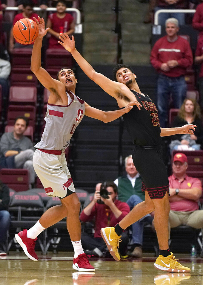Stanford forward Oscar da Silva (13) steals the ball from Southern California forward Bennie Boatwright (25) during the second half of an NCAA college basketball game Wednesday, Feb. 13, 2019, in Stanford, Calif. Stanford won 79-76. (AP Photo/Tony Avelar)