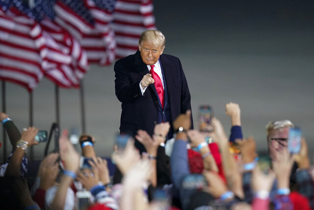 President Donald Trump arrives at a campaign rally at Des Moines International Airport, Wednesday, Oct. 14, 2020, in Des Moines, Iowa. (AP Photo/Charlie Neibergall)