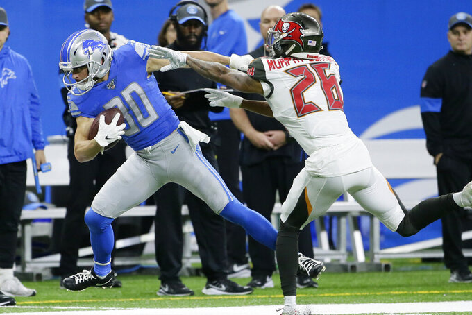 Detroit Lions wide receiver Danny Amendola (80) is pushed out of bounds by Tampa Bay Buccaneers defensive back Sean Murphy-Bunting (26) during the first half of an NFL football game, Sunday, Dec. 15, 2019, in Detroit. (AP Photo/Duane Burleson)