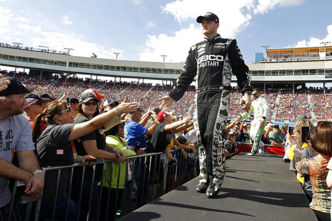 Ty Dillon greets fans during driver introductions prior to the NASCAR Cup Series auto race at ISM Raceway, Sunday, Nov. 10, 2019, in Avondale, Ariz. (AP Photo/Ralph Freso)