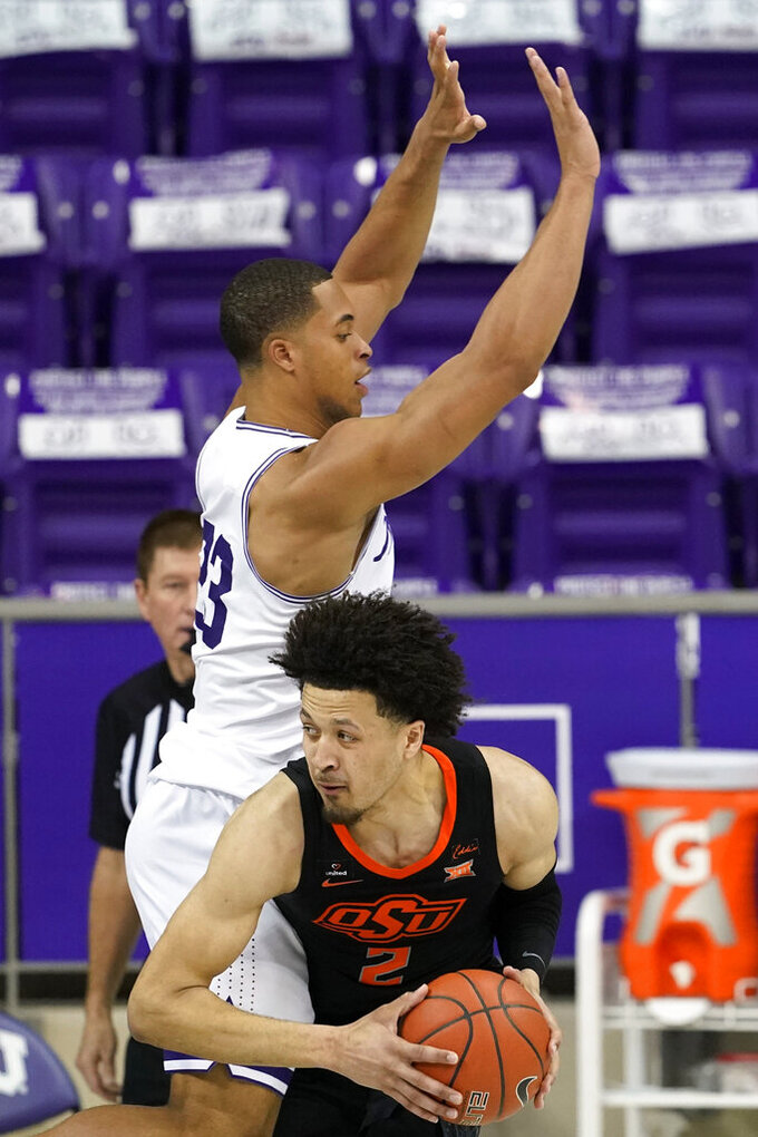 Oklahoma State guard Cade Cunningham (2) looks for an opening to the basket as TCU's Jaedon LeDee (23) defends during the second half of an NCAA college basketball game in Fort Worth, Texas, Wednesday, Feb. 3, 2021. (AP Photo/Tony Gutierrez)