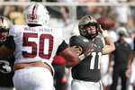 Central Florida quarterback Dillon Gabriel (11) throws a pass as he is pressured by Stanford defensive tackle Dalyn Wade-Perry (50) during the first half of an NCAA college football game, Saturday, Sept. 14, 2019, in Orlando, Fla. (AP Photo/John Raoux)