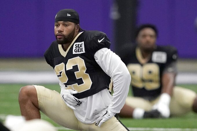New Orleans Saints cornerback Marshon Lattimore stretches during football practice at the TCU indoor facility in Fort Worth, Texas, Wednesday, Sept. 8, 2021. The Saints, displaced in Texas after Hurricane Ida, switched to TCU after three days last week in the Dallas Cowboys' stadium. They open the season against Green Bay, which was moved from New Orleans to Jacksonville. (AP Photo/Tony Gutierrez)