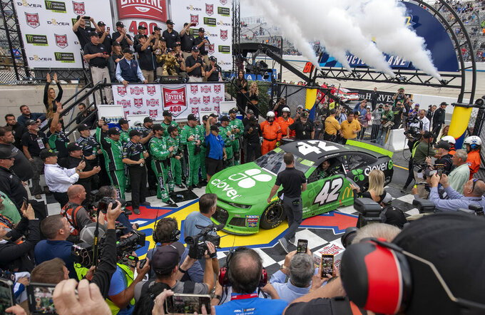 Kyle Larson drives into Victory Lane after winning the NASCAR Cup Series playoff auto race Sunday, Oct. 6, 2019, at Dover International Speedway in Dover, Del. (AP Photo/Jason Minto)