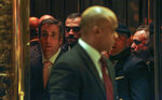 In this Dec. 12, 2016 photo, Los Angeles venture capitalist Imaad Zuberi, far right, stands in an elevator with former Donald Trump attorney Michael Cohen, far left, at Trump Tower in New York. Zuberi has agreed to plead guilty to making illegal campaign contributions on behalf of foreign nationals and has been under scrutiny by federal prosecutors in New York after he donated $900,000 to Trump's inaugural committee and $100,000 to a Republican campaign committee around the time Zuberi accompanied Qatar's foreign minister to a meeting in Trump Tower. (AP Photo/Kathy Willens)