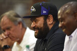 Former Baltimore Ravens NFl football player Haloti Ngata, center, speaks about his retirement during a news conference with former head coach Brian Billick, left, and former general manager Ozzie Newsome, Wednesday, May 29, 2019, in Owings Mills, Md. (AP Photo/Gail Burton)