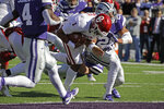 Oklahoma quarterback Jalen Hurts (1) gets past Kansas State defensive back Denzel Goolsby (20) to score a touchdown during the first half of an NCAA college football game Saturday, Oct. 26, 2019, in Manhattan, Kan. (AP Photo/Charlie Riedel)