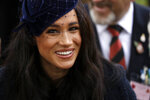 FILE - Meghan the Duchess of Sussex meets veterans and serving members of the military as she attends the official opening of the annual Field of Remembrance at Westminster Abbey on Nov. 7, 2019, in London. Markle turns 39 on Aug. 4. (AP Photo/Matt Dunham, File)
