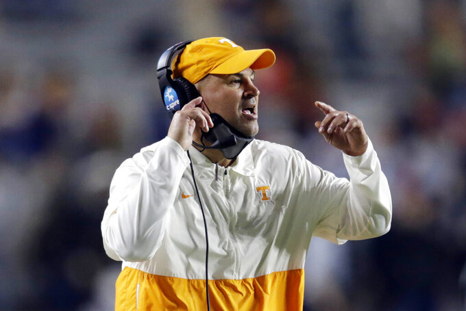 FILE - Tennessee coach Jeremy Pruitt calls out to his players during the first half of an NCAA college football game against Auburn in Aubuen, Ala., in this Saturday, Nov. 21, 2020, in file photo. Tennessee fired Pruitt Monday, Jan. 18, 2021. (AP Photo/Butch Dill, File)