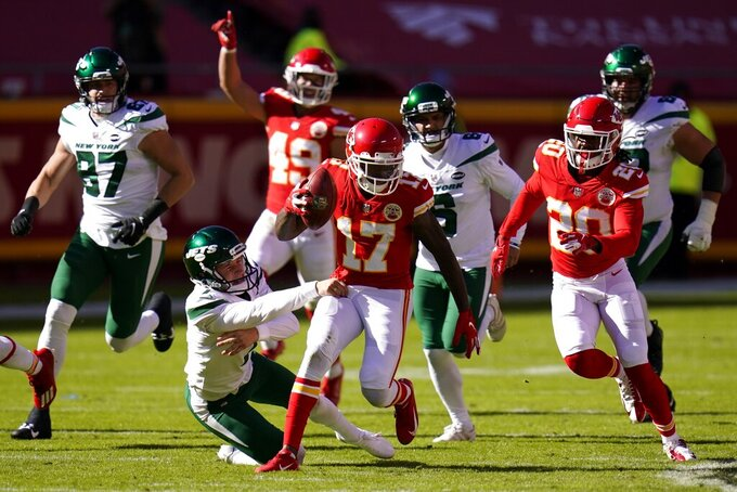 New York Jets punter Braden Mann (7) attempts to stop Kansas City Chiefs wide receiver Mecole Hardman (17) from advancing the ball after the Chiefs blocked a field goal attempt by the Jets late in the first half of an NFL football game on Sunday, Nov. 1, 2020, in Kansas City, Mo. (AP Photo/Jeff Roberson)