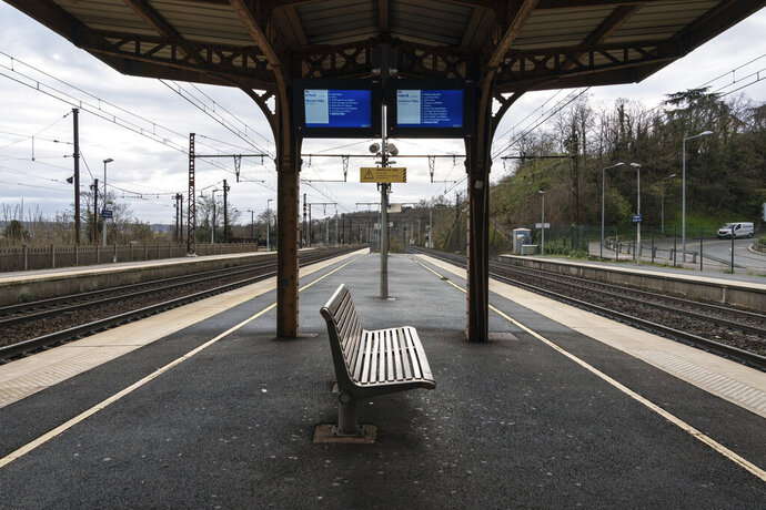 An empty platform is pictured during a railway strike at the Saint Germain au Mont d'Or train station, around Lyon, central France, Monday, Dec. 9, 2019. French commuters inched to work Monday through exceptional traffic jams, as strikes to preserve retirement rights halted trains and subways for a fifth straight day. Citing safety risks, the SNCF national rail network issued warned travelers to stay home or use