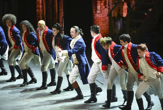FILE - In this June 12, 2016 file photo, Lin-Manuel Miranda, center, and the cast of
