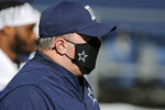 Dallas Cowboys head coach Mike McCarthy wears a star on his mask on the sideline during the second half of an NFL football game against the Seattle Seahawks, Sunday, Sept. 27, 2020, in Seattle. (AP Photo/John Froschauer)