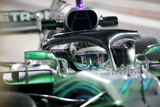 Mercedes driver Valtteri Bottas of Finland steers his car during the second free practice at the Yas Marina racetrack in Abu Dhabi, United Arab Emirates, Friday Nov. 23, 2018. The Emirates Formula One Grand Prix will take place on Sunday. (AP Photo/Luca Bruno)