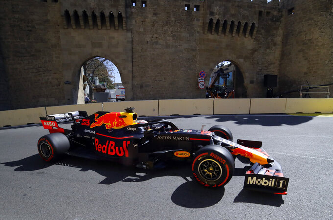 Red Bull driver Max Verstappen of the Netherland's steers his car during the third free practice at the Baku Formula One city circuit in Baku, Azerbaijan, Saturday, April 27, 2019. The Azerbaijan F1 Grand Prix race will be held on Sunday. (AP Photo/Sergei Grits)