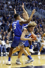 Butler's Joey Brunk goes to the basket against Creighton's Ty-Shon Alexander (5) and Samson Froling during the first half of an NCAA college basketball game, Saturday, Jan. 5, 2019, in Indianapolis. (AP Photo/Darron Cummings)