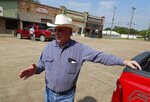 """In this Aug. 5, 2019, photo, Tom Ramsay stands near his office in the town square as he responds to questions about Art Briles and his position as the head coach at Mount Vernon High School football team in Mount Vernon, Texas. """"I think we're lucky to have him and I'm going to support him 100 percent,"""" said Ramsay, a former five-term state representative whose real estate office is on the town square. """"(AP Photo/Tony Gutierrez)"""
