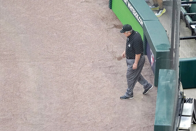 Umpire Joe West steps on the field before an interleague baseball game between the Chicago White Sox and the St. Louis Cardinals, Monday, May 24, 2021, in Chicago. West now ties the major league record for games umpired. (AP Photo/Charles Rex Arbogast)