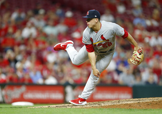 FILE - In this Aug. 15, 2019, file photo, St. Louis Cardinals relief pitcher Ryan Helsley throws against the Cincinnati Reds during the eighth inning of a baseball game in Cincinnati. Helsley was disappointed by his first exposure to the Atlanta Braves' fans use of the Tomahawk Chop for their chants during games. Helsley's vantage point is different than most players who visit SunTrust Park. He is a member of the Cherokee nation.  (AP Photo/Gary Landers, File)