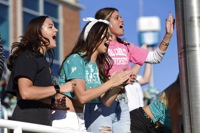 Coastal Carolina fans react during the second half of an NCAA college football game against Appalachian State, Saturday, Nov. 21, 2020, in Conway, S.C. (AP Photo/Richard Shiro)