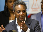 On the fifth day of the Chicago Teachers Union strike, Mayor Lori Lightfoot speaks to reporters after visiting Chicago Public Schools students at a contingency site, James R. Jordan Boys & Girls Club in Chicago, Monday, Oct. 21, 2019. (Ashlee Rezin Garcia/Chicago Sun-Times via AP)