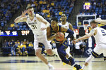 North Colorado's Matt Johnson(2) drives it up the court against West Virginia's Logan Routt (31), Taz Sherman (behind) and Jordan McCabe (5) during the first half of an NCAA college basketball game Monday Nov. 18, 2019, Morgantown, W.Va. (AP Photo/Kathleen Batten)