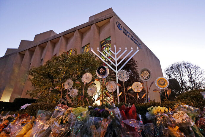 File - In this Sunday, Dec. 2, 2018 file photo, a menorah is installed outside the Tree of Life Synagogue in preparation for a celebration service at sundown on the first night of Hanukkah, in the Squirrel Hill neighborhood of Pittsburgh. A gunman shot and killed 11 people while they worshipped Saturday, Oct. 27, 2018 at the temple. Israeli researchers reported Wednesday that violent attacks against Jews spiked significantly last year, with the largest reported number of Jews killed in anti-Semitic acts in decades, leading to an