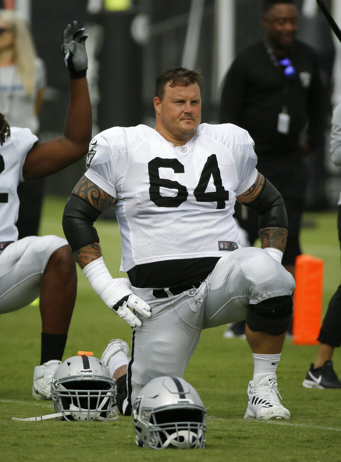 "FILE - In this July 29, 2019, file photo, Oakland Raiders center Richie Incognito (64) stretches during NFL football training camp in Napa, Calif. The Oakland Raiders and their big personalities like Antonio Brown and Richie Incognito are ready to be stars on HBO's ""Hard Knocks."" (AP Photo/Eric Risberg, File)"