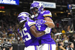 Minnesota Vikings running back Alexander Mattison (25) celebrates his touchdown reception with tight end Irv Smith in the first half of an NFL preseason football game against the New Orleans Saints in New Orleans, Friday, Aug. 9, 2019. (AP Photo/Bill Feig)
