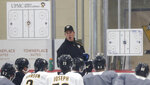 Pittsburgh Penguins coach Mike Sullivan, center, instructs the team on a drill during NHL hockey practice on the team's first day of training camp, Friday, Sept. 13, 2019, in Cranberry Township, Butler County, Pa. (AP Photo/Keith Srakocic)