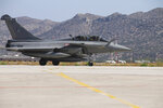 CORRECTS SPELLING OF DEFENCE In this photo provided by the Greek National Defence, a French Rafale fighter jet at Souda airbase on the island of Crete, Thursday, Aug. 13, 2020. Greece's prime minister warmly thanked France Thursday for its decision to boost its military presence in the eastern Mediterranean, where Greek and Turkish warships are closely shadowing each other over a Turkish energy exploration bid in waters Athens claims as its own. (Hellenic National Defence via AP)