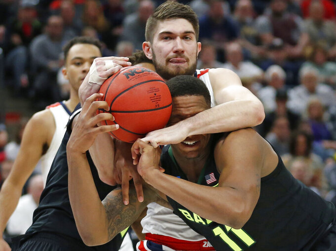 Gonzaga forward Killian Tillie, rear, battles with Baylor guard Mark Vital (11) for a rebound during the first half of a second-round game in the NCAA men's college basketball tournament Saturday, March 23, 2019, in Salt Lake City. (AP Photo/Rick Bowmer)