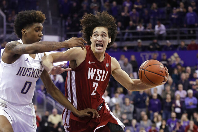 FILE - In this Feb. 28, 2020, file photo, Washington State's CJ Elleby (2) drives against Washington's Jaden McDaniels (0) during the second half of an NCAA college basketball game in Seattle. Elleby was the 46th pick in the NBA draft on Wednesday night, Nov. 19, selected by the Trail Blazers. He became the first Washington State player drafted since Klay Thompson in 2011. (AP Photo/Elaine Thompson, File)