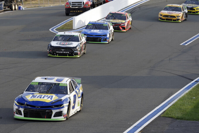 Chase Elliott leads Kevin Harvick out of Turn 2 during the NASCAR Cup Series auto race at Charlotte Motor Speedway in Concord, N.C., Sunday, Sept. 29, 2019. (AP Photo/Gerry Broome)