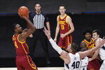 Southern California's Evan Mobley, left, shoots over BYU's Kolby Lee in the first half of an NCAA college basketball game, Tuesday, Dec. 1, 2020, in Uncasville, Conn. (AP Photo/Jessica Hill)